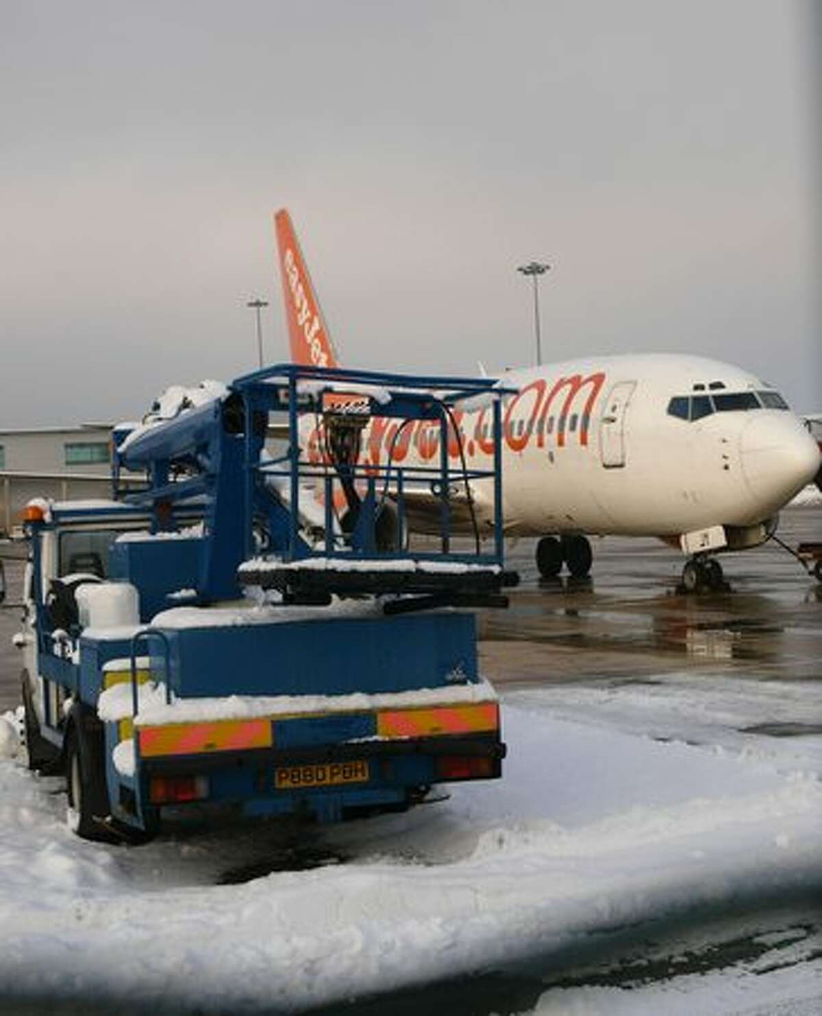 An easyJet aircraft is parked near a maintenance truck at Luton airport, north of London, on Dec. 22, 2009. Budget airline easyJet canceled more than 150 flights Tuesday due to severe weather conditions, in a fresh blow to European passengers hoping to travel for the Christmas holidays. British Airways and Irish low-budget carrier Ryanair also warned of delays and cancellations due to the heavy snow and freezing temperatures, which have already caused chaos on the roads and suspended Eurostar train services.