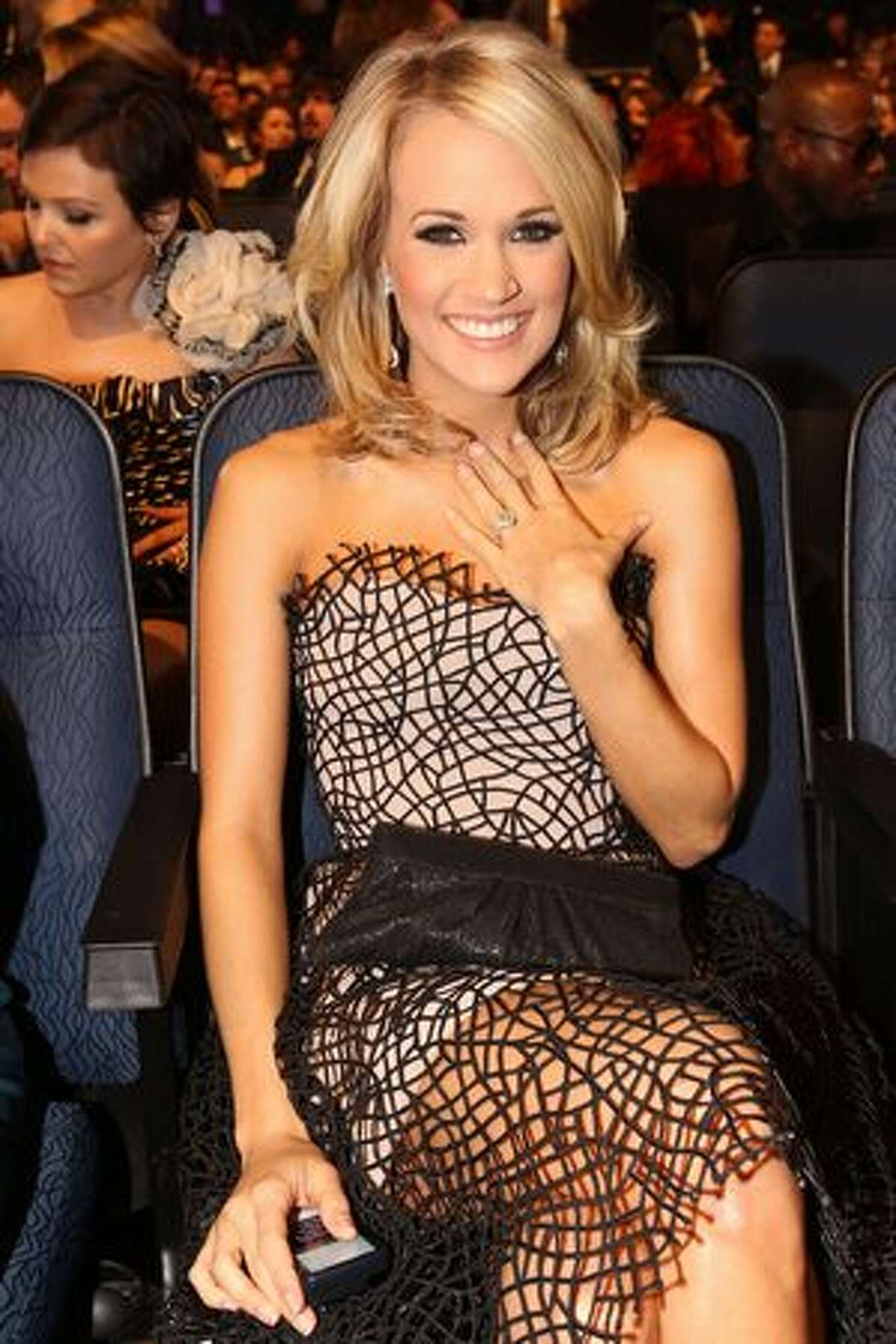 Singer Carrie Underwood poses in the audience.