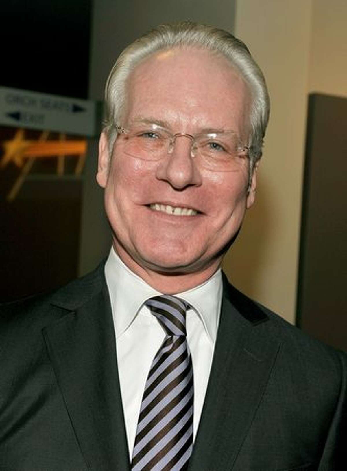 TV personality Tim Gunn poses backstage.