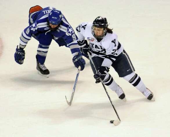 Yale's #23 Kevin Peel gives Air Force's #9 Kyle De Laurell the slip as he moves the puck, during NCAA hockey tournament action at the Webster Bank Arena at Harbor Yard in Bridgeport on Wednesday March 25, 2011. Photo: Christian Abraham / Connecticut Post