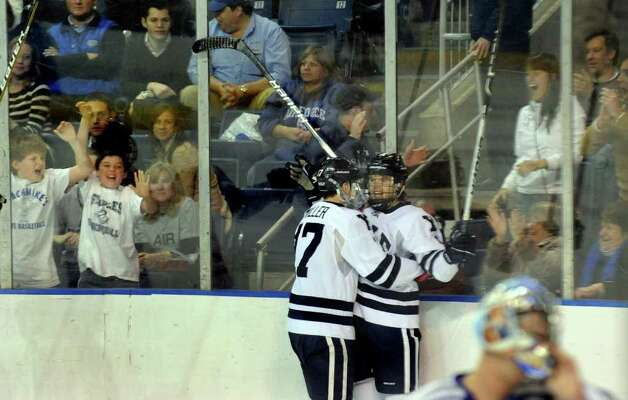 Yale's #17 Andrew Miller hugs teammate #9 Brian O'Neill, at right, after O'Neill scored against Air Forcce, during NCAA hockey tournament action at the Webster Bank Arena at Harbor Yard in Bridgeport on Wednesday March 25, 2011. Photo: Christian Abraham / Connecticut Post