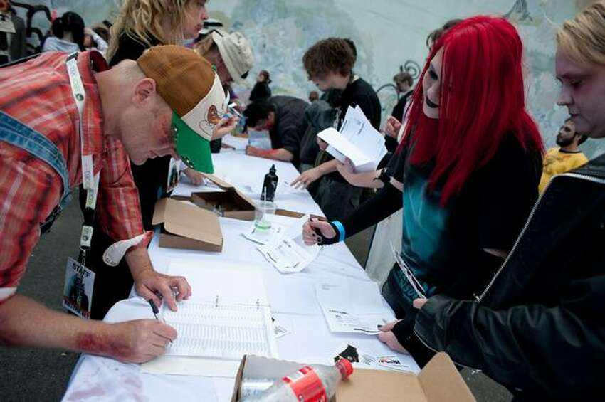 Participants register at the entrance to the walk. Organizers hope to beat England's record of 4,026 zombies set just last year.
