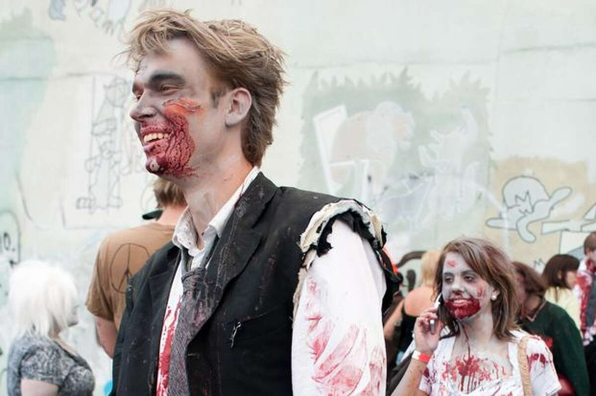 Participants dress in elaborate and bloodied costumes during the Zombie Walk in Fremont.