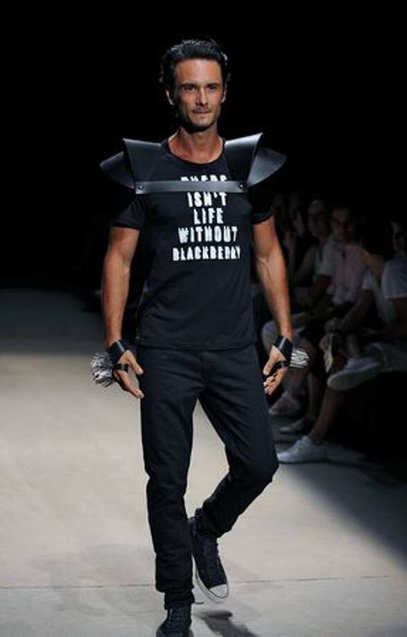 Brazilian actor Rodrigo Santoro presents a creation by designer Auslander during the Rio Fashion Week Autumn-Winter 2010 collection, at the Pier Maua in Rio de Janeiro, Brazil. Photo: Getty Images