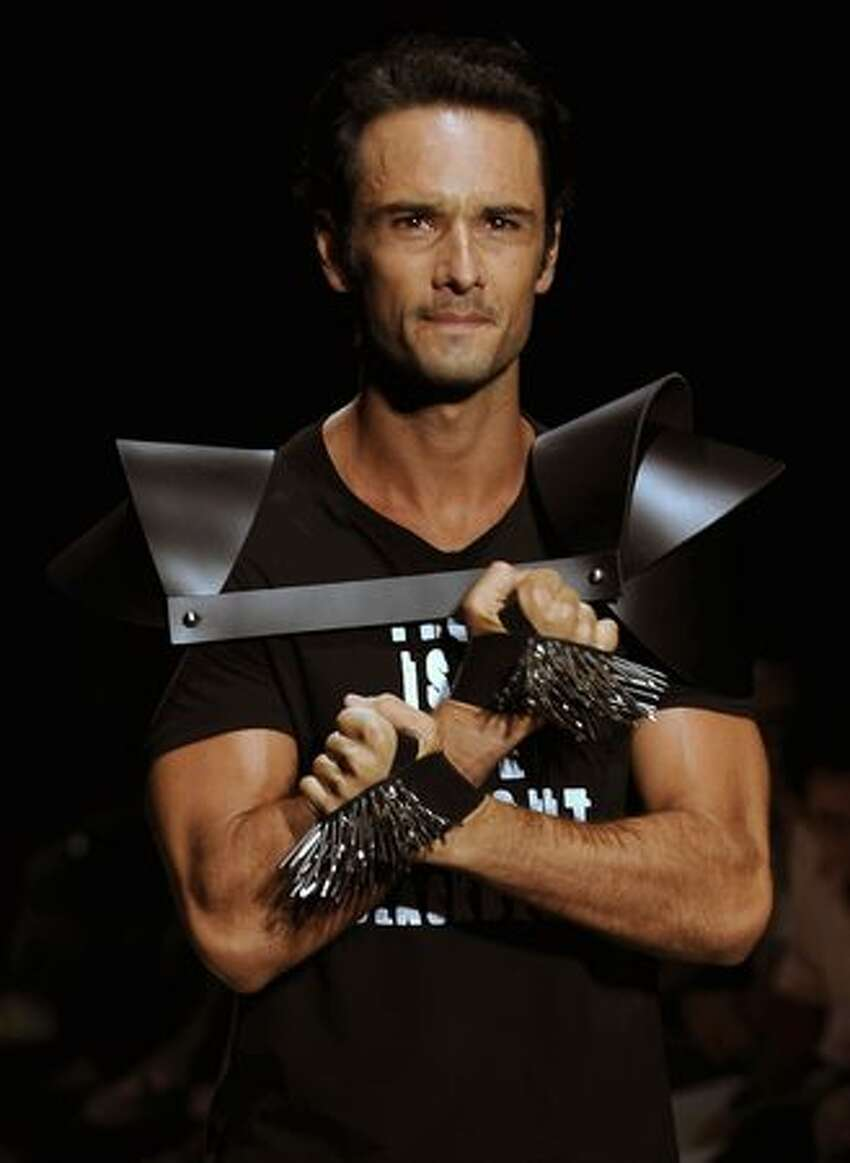 Brazilian actor Rodrigo Santoro presents a creation by designer Auslander during the Rio Fashion Week Autumn-Winter 2010 collection, at the Pier Maua in Rio de Janeiro, Brazil.