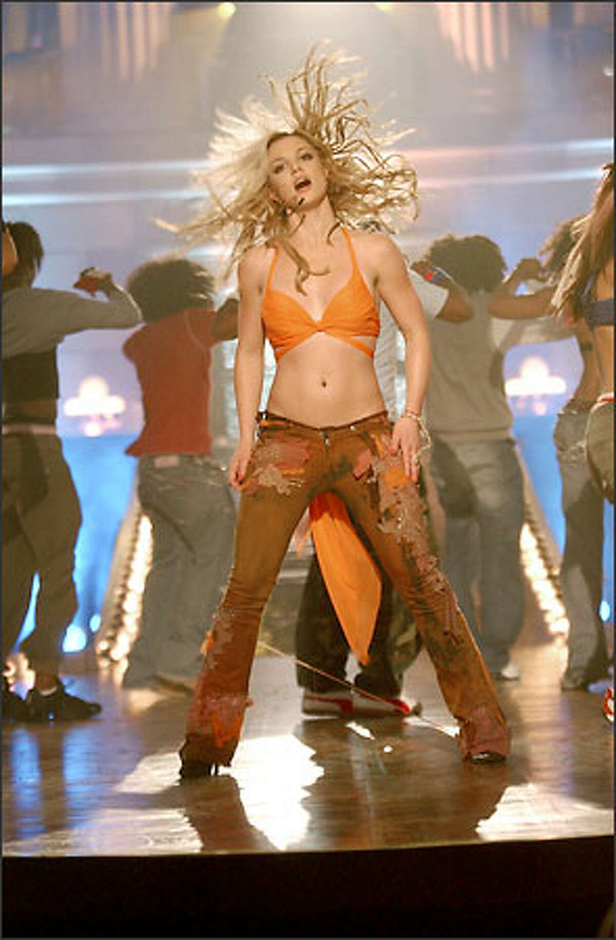 """Twenty-one-year-old singing sensation Britney Spears stars in an original primetime special Monday. """"Britney Spears: In the Zone"""" will feature exclusive performance footage interwoven with a behind-the-scenes look at her hectic life."""