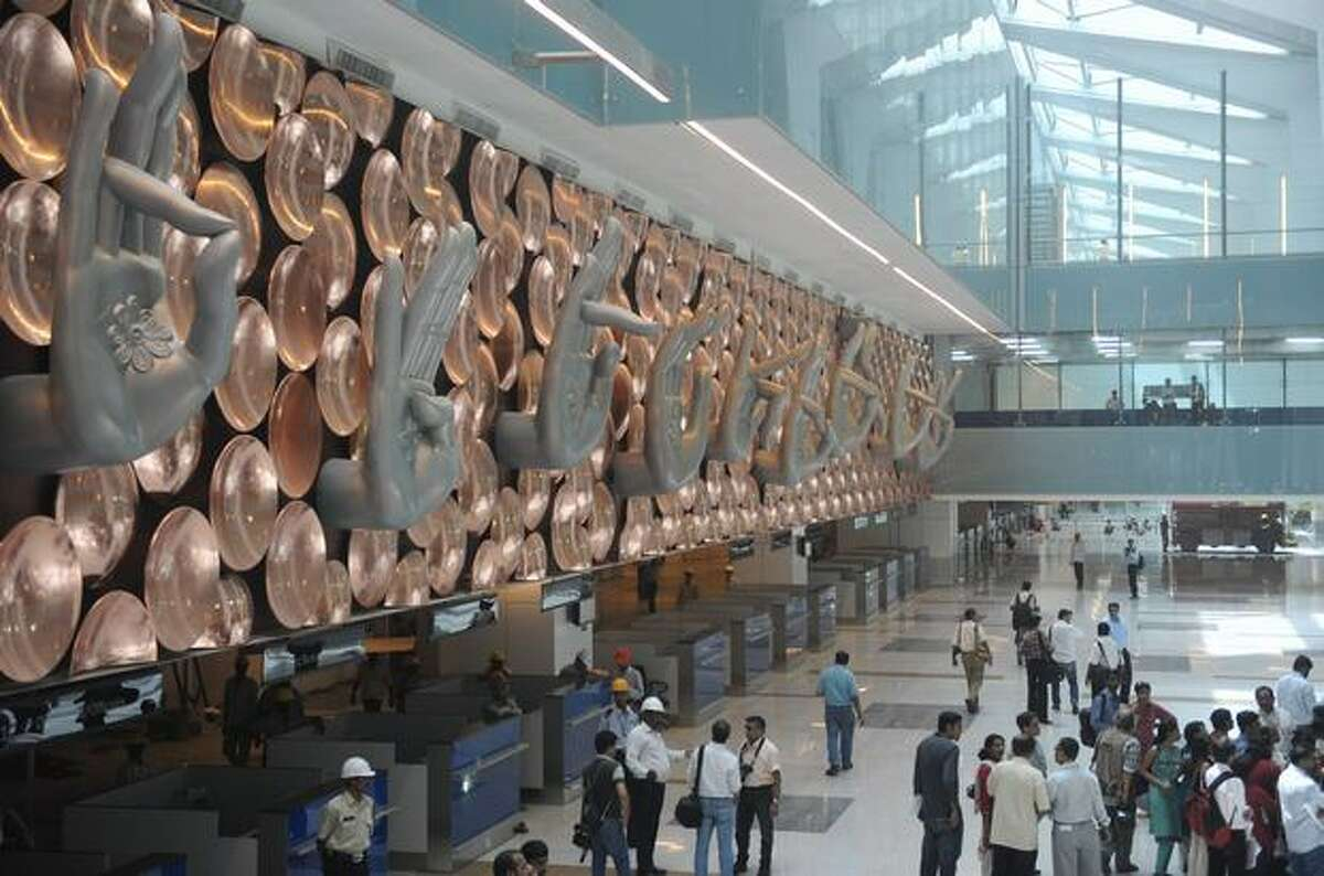 People inspect the newly built terminal 3 of the Indira Gandhi International Airport in New Delhi. Terminal 3, which will be inaugurated July 3, has the capacity to handle 34 million passengers annually.