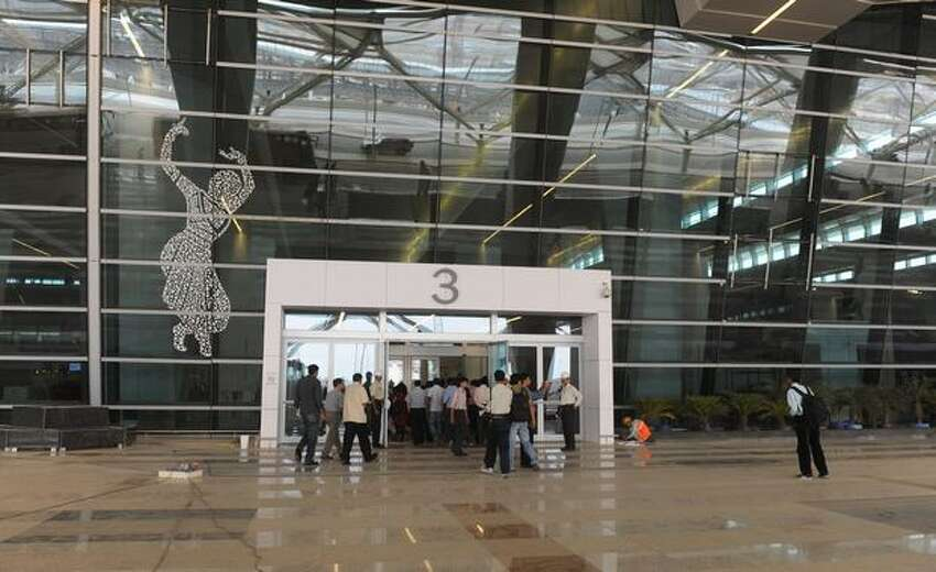 People enter the newly built terminal 3 of the Indira Gandhi International Airport in New Delhi. Terminal 3, which will be inaugurated July 3, has the capacity to handle 34 million passengers annually.