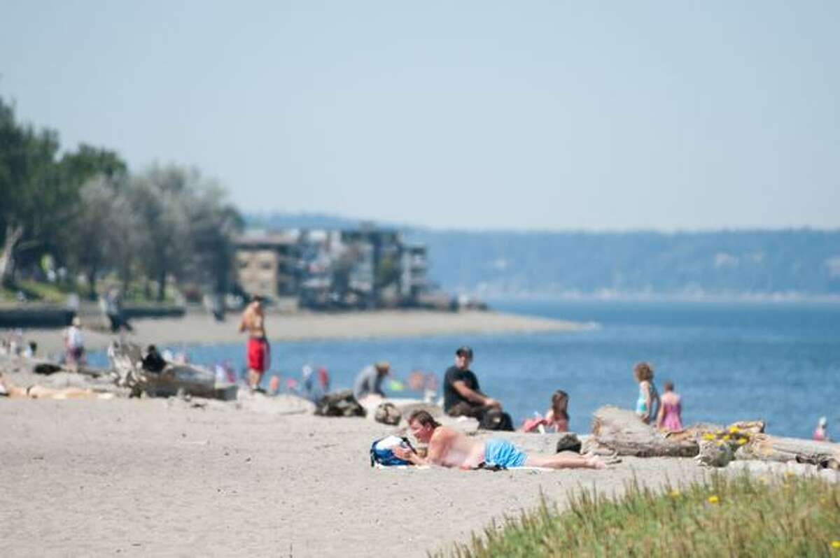 Seattleites flock to beaches and parks on a hot summer day.