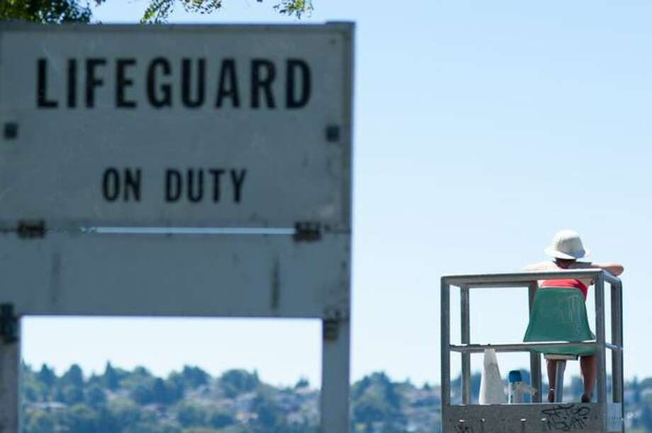 Seattle's lifeguarded swimming areas to remain closed due to COVID-19, budget cuts Photo: Elliot Suhr, Seattlepi.com