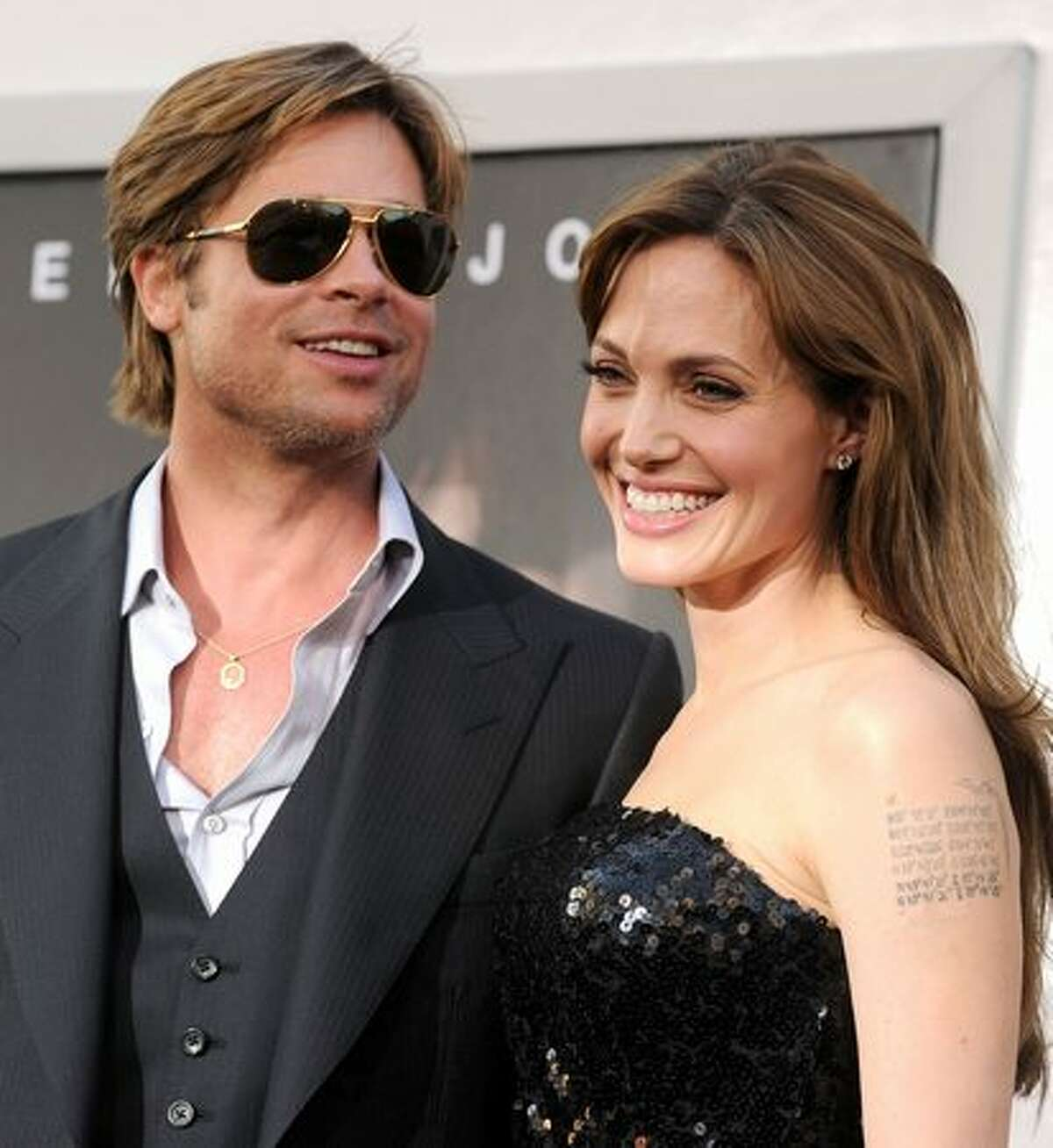 Actor Brad Pitt (L) and actress Angelina Jolie arrive.