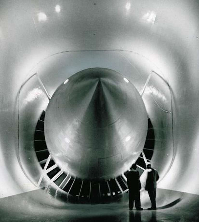 This cutaway image from 1953 shows the details of the modified Boeing wind tunnel. The two-stage 24-foot fan forces air past the 18-foot nacelle around the two turns and into the test section. Photo: P-I File