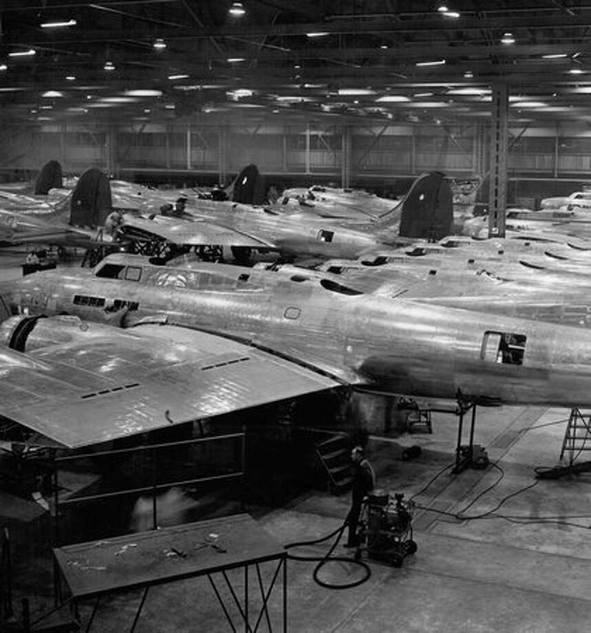 Boeing B-17 Flying Fortresses in this picture are acquiring their wing and tail assemblies in an advanced stage of quantity production. Photo: P-I File