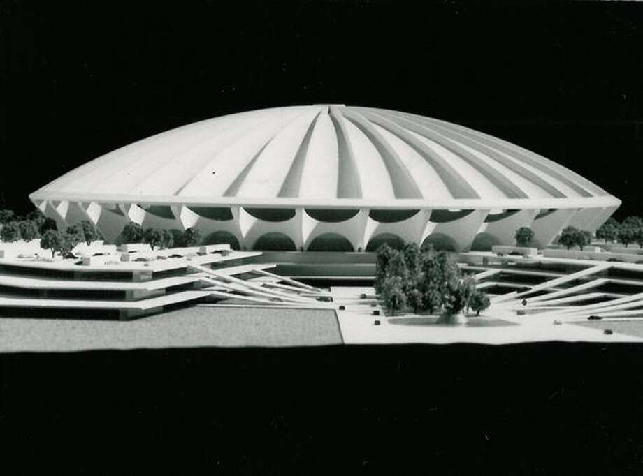 The January 1969 photo caption read: A bold, Eye-catching design, the Harris & Reed wood dome concept typifies the architectural possibilities which could make King County's stadium world famous. Preliminary design and engineering studies project a seating capacity of 52,000 for baseball and 56,000 for football. Photo: P-I File