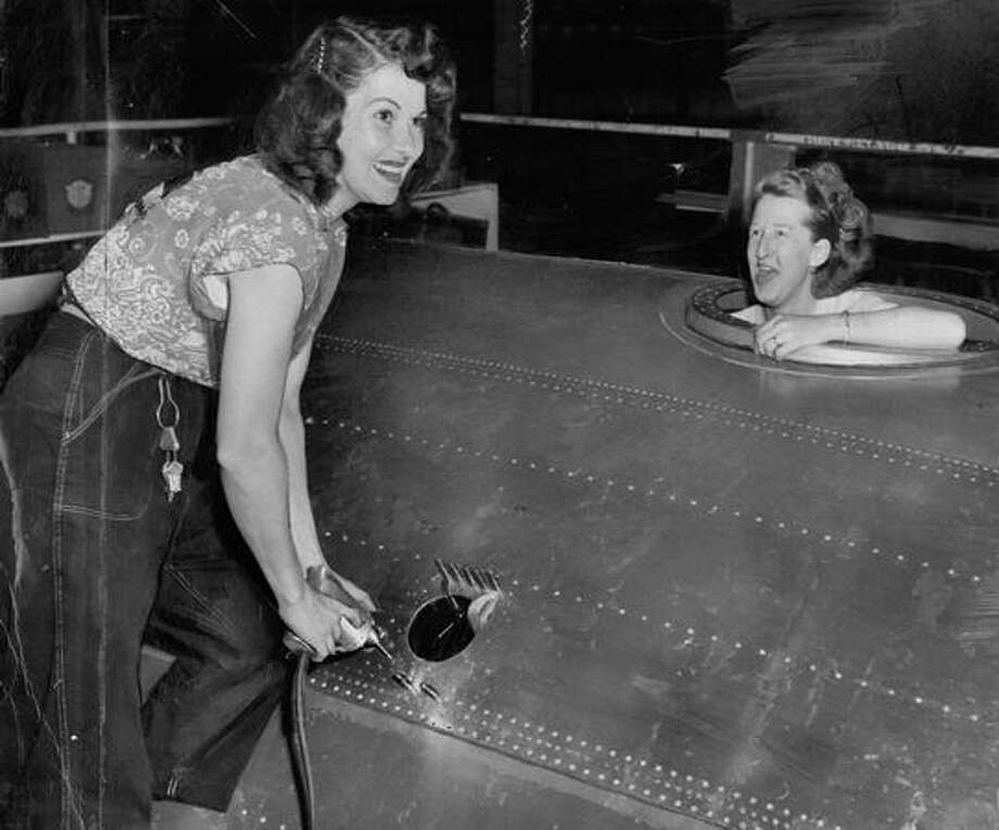 The 1956 caption for this photo read: A real-life Rosie the Riveter, Mrs. Rosalie Glenn of Renton, works with Mrs. Bonnie Carlisle of Redondo Beach of the nose section of a C-97 at the Boeing Airplane Co's Renton Plant. Photo: P-I File