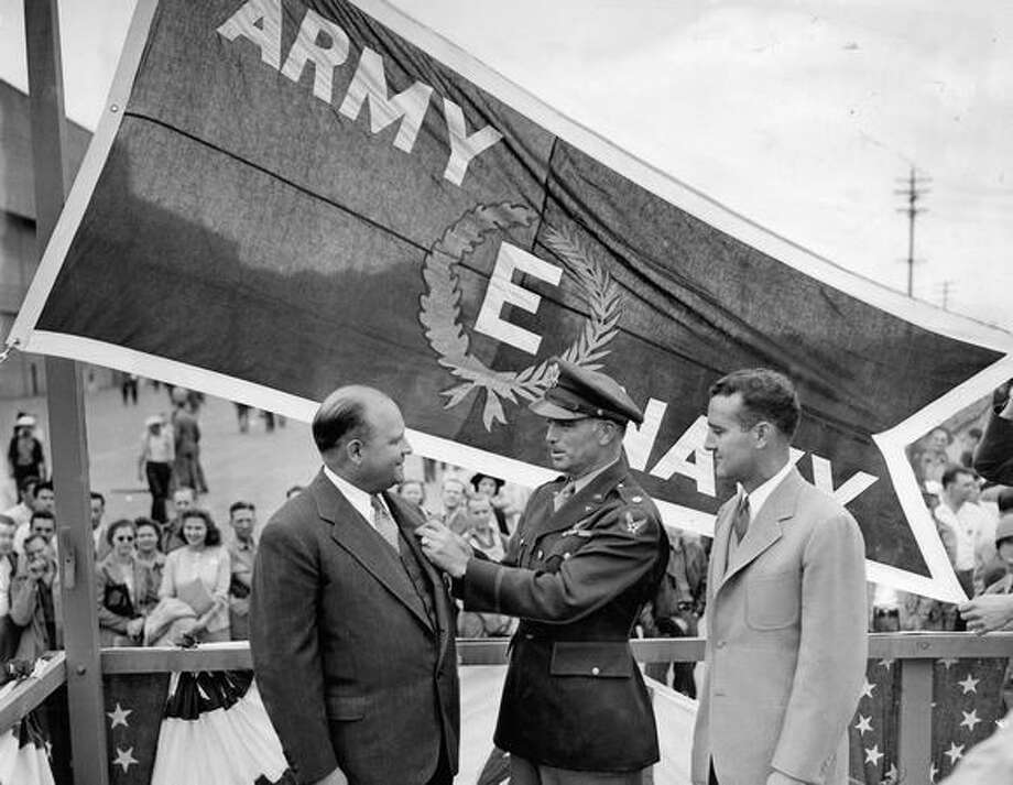 Lt. Col. Wiley R, Wright pinning an Army-Navy emblem on Boeing Aircraft Co. President Philip G. Johnson in 1942. Photo: P-I File