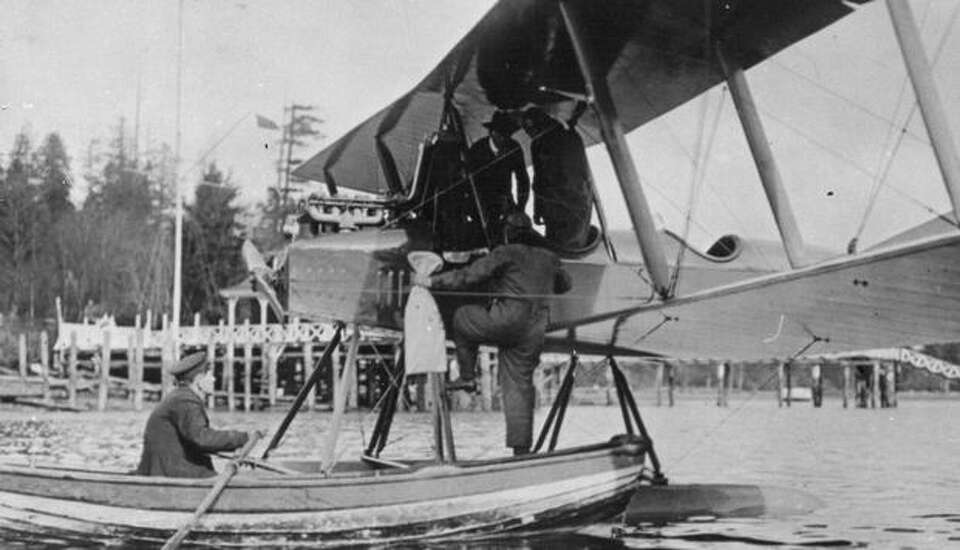 This photo shows W.E. Boeing climbing aboard the seaplane in which he and Eddie Hubbard made the fir