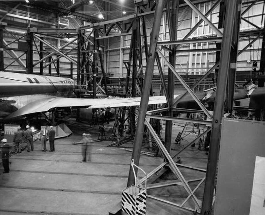The prototype Boeing 707 jet transport is shown in the structural test facility at the company's flight test hanger at Seattle. Exact date unknown. The Boeing 707 prototype, model 367-80, made its maiden flight from Renton Field on July 15, 1954. Photo: P-I File