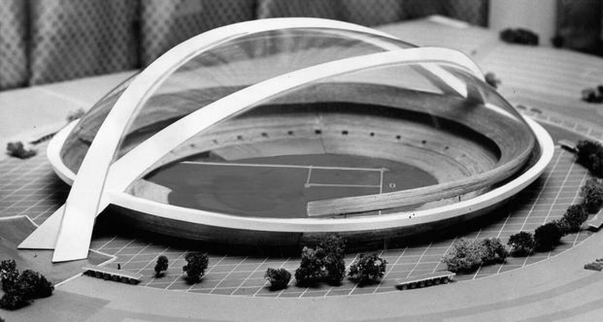 The 1960s photo caption read: This is the type of all-purpose, all-weather athletic plant Seattle will get if the bond issue is approved by voters. The photo of the model was taken through the plastic covering which makes baseball-in-the-rain possible. County Commissioners will vote on the proposal soon, after researchers recently pronounced the plan feasible.