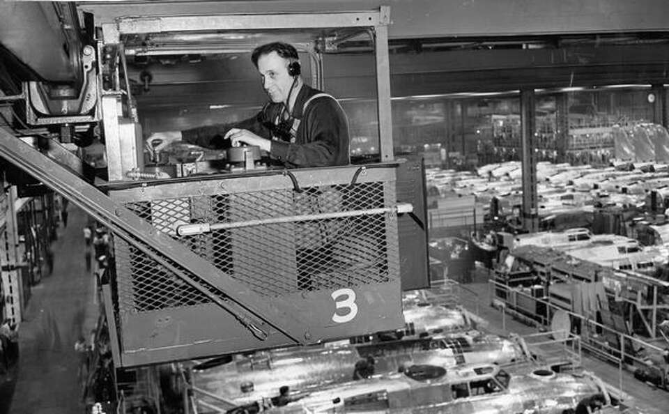This 1944 photo shows Stuart E. Kieffer, Boeing crane operator, talking over a communications system