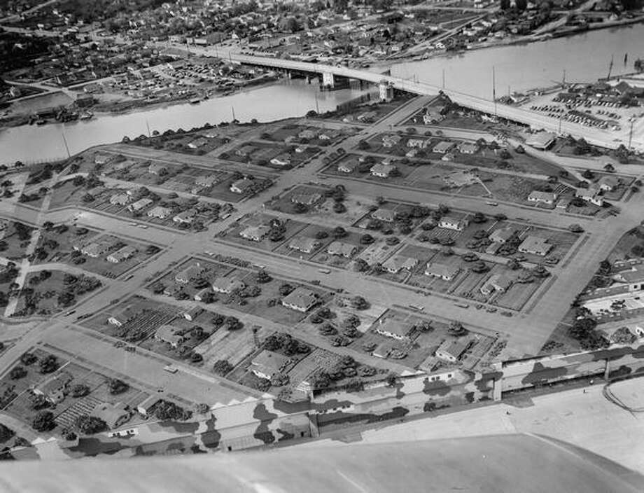 A camouflage cover disguises the Seattle Boeing plant as a residential neighborhood in the early 1940s. Photo: P-I File