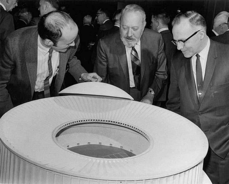 The April 1969 photo caption read: William Haselton, vice president and general manager of the Forest Products Division of St. Regis Paper Co; Norton Clapp, chairman of the board of Weyerhaeuser Co., and John Hess of the host committee. The look over a model designed for Weyerhaeuser Co. which calls for a clear span of 840 feet which reaches 250 feet in height at its apex. By comparison the Houston Astrodome measures only 642 feet in diameter and rises only 206 feet above ground. Photo: P-I File