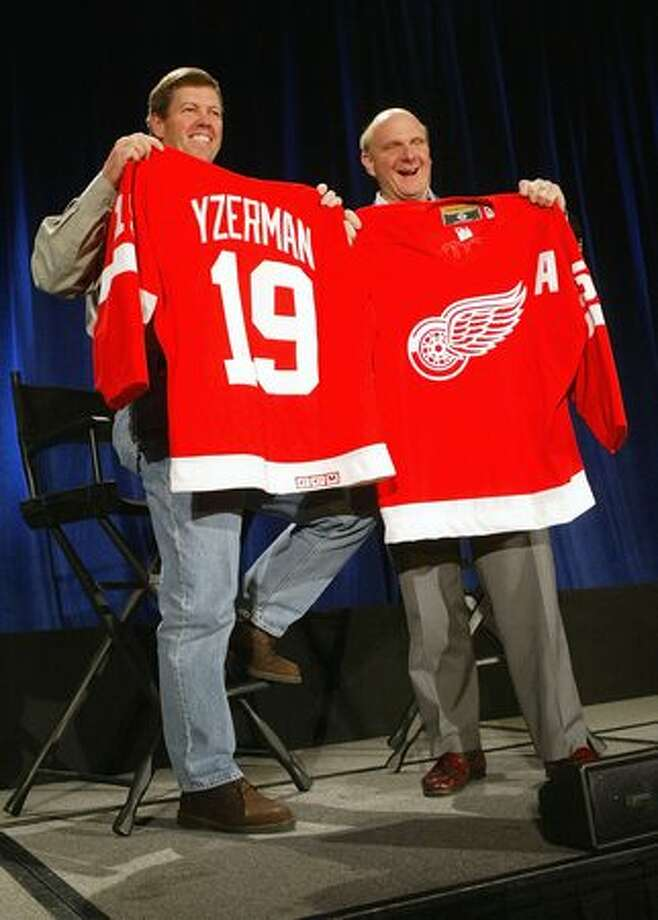 Sun Microsystems CEO Scott McNealy, left, and Ballmer hold up Detroit Red Wings hockey jerseys that they exchanged with each other during a media conference April 2, 2004, in San Francisco. Microsoft and Sun announced they had entered into a broad agreement to enable their products to work better together and to settle all pending litigation between the two companies. Photo: Getty Images
