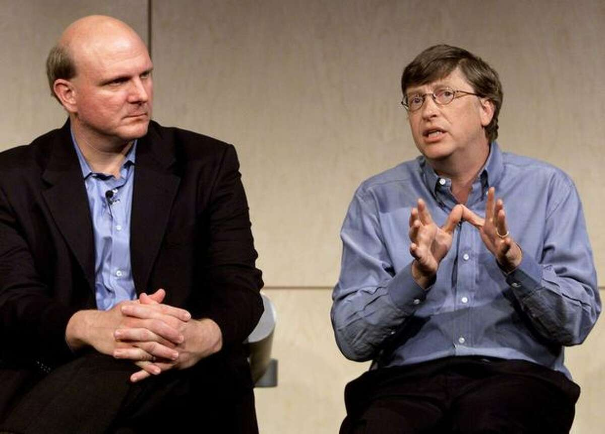 Bill Gates, right, and Steve Ballmer talk to members of the media during Forum 2000 at Microsoft's Redmond headquarters on June 22, 2000. Gates unveiled Microsoft's vision for the next generation of the Internet, called the