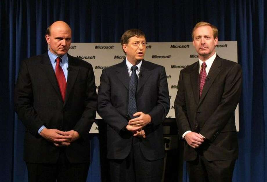 Ballmer, Gates and Chief Counsel Brad Smith, right, answer questions Nov. 1, 2002, in Redmond after a judge approved a hotly disputed deal between Microsoft and the US government to settle a four-year battle over the software titan's illegal squelching of competitors. Photo: Getty Images