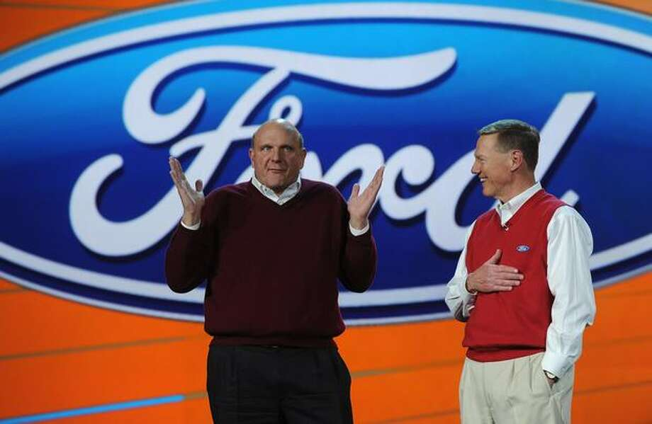 Microsoft CEO Steve Ballmer joins Ford CEO Alan Mulally, right, during Mulally's keynote address Jan. 8, 2009, at the 2009 Consumer Electronics Show in Las Vegas.Click on for more photos of Mulally at Ford and during his previous stint at Boeing. Photo: Getty Images