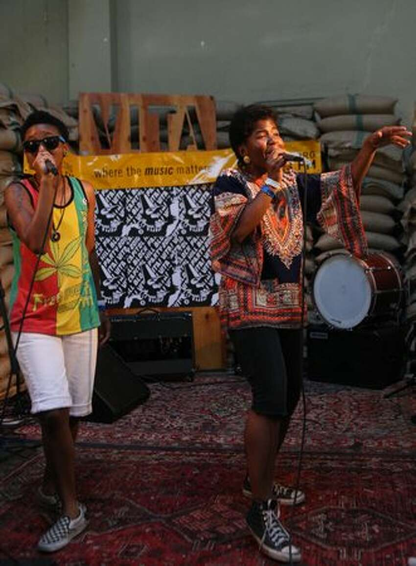 THEESatisfaction perfroms in the bean room at Cafe Vita, during the Capitol Hill Block Party.