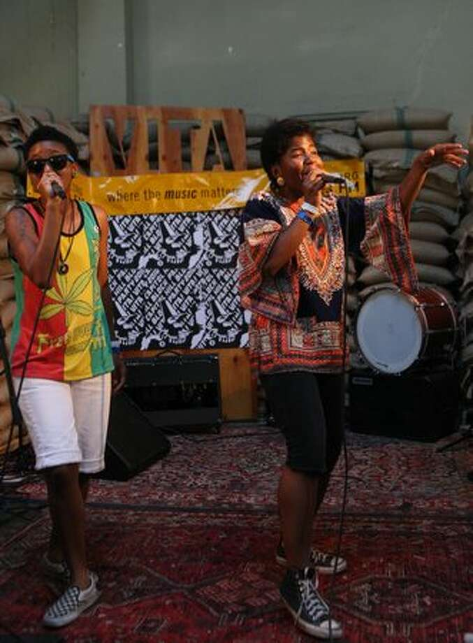 THEESatisfaction perfroms in the bean room at Cafe Vita, during the Capitol Hill Block Party. Photo: William Baldon, Seattlepi.com