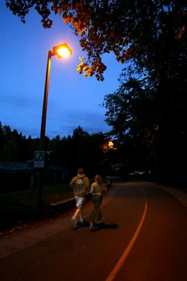A couple of runners along the path at Green Lake, June 2005. Photo: P-I File