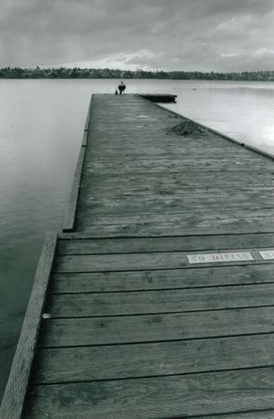 Fisherman Brian Henaby on a long Green Lake dock, Nov. 29, 1993.