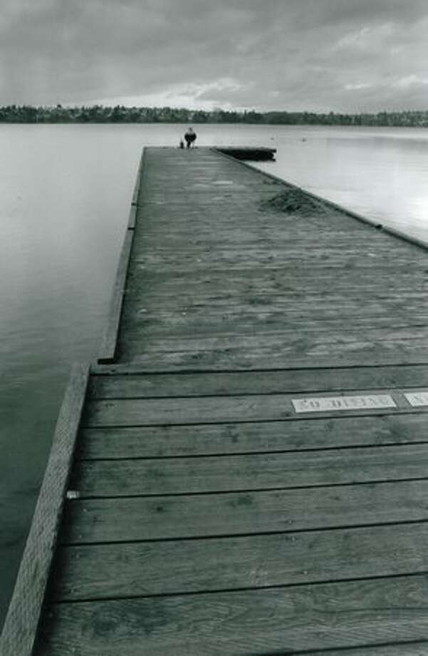 Fisherman Brian Henaby on a long Green Lake dock, Nov. 29, 1993. Photo: P-I File