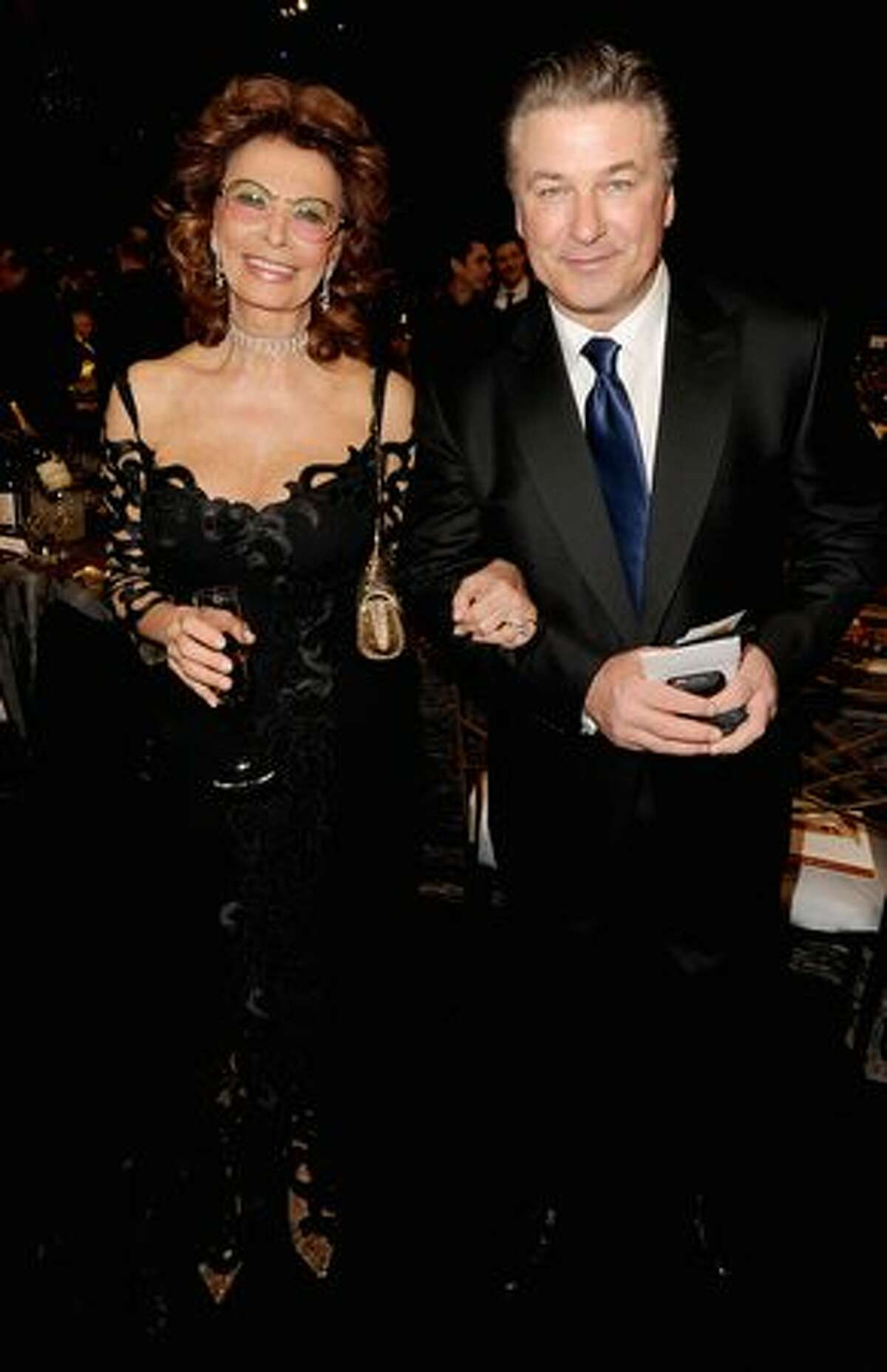 Actress Sophia Loren (L) and actor Alec Baldwin attend.