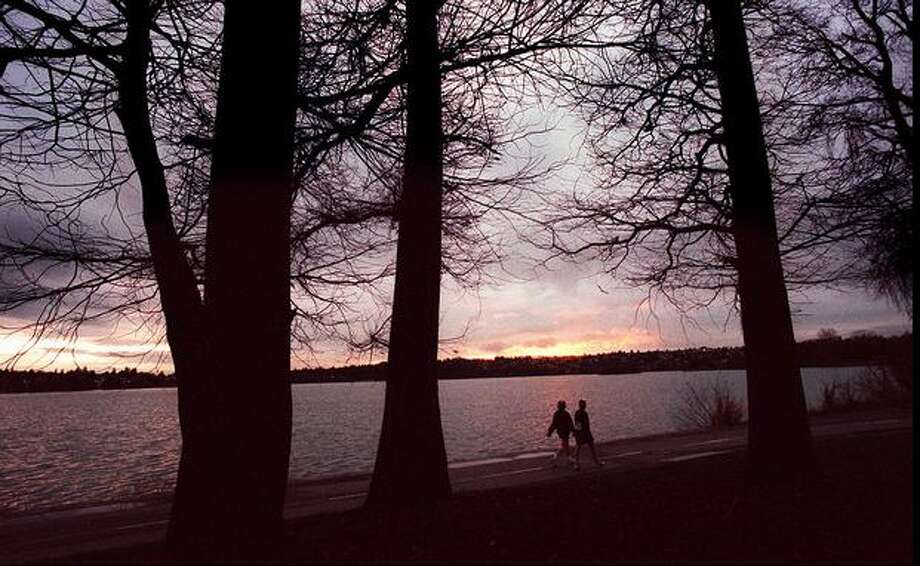 Two walkers troll on the path around Green Lake, Dec. 18, 1995. (Ellen M. Banner/Seattlepi.com file) Photo: P-I File