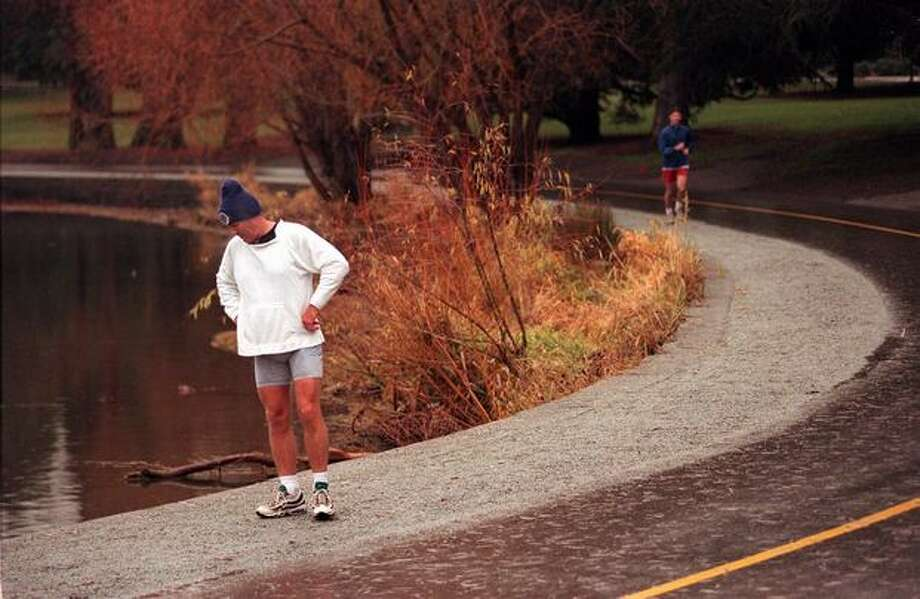 Leonard Peterson came to Green lake in 1996 to run on the new section of path Dec. 20 of that year. Photo: P-I File