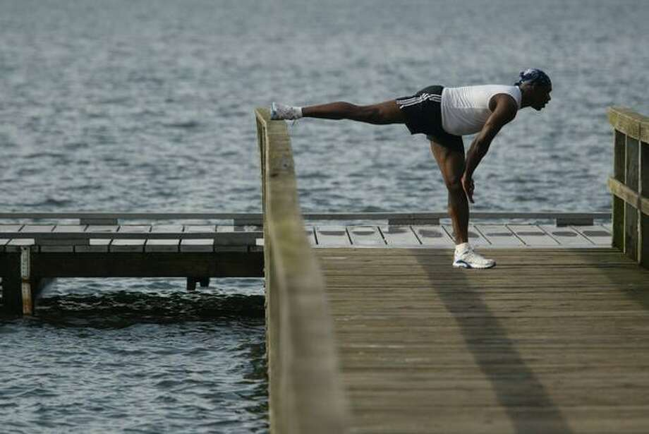 "The January 2005 caption read: Reynold Cottle, who resides in Snohomish, stretches after running around Green Lake. ""It feels like summer"" said Cottle about the unseasonably warm temperatures of more than 60 degrees. (Dan DeLong/Seattlepi.com file) Photo: P-I File"