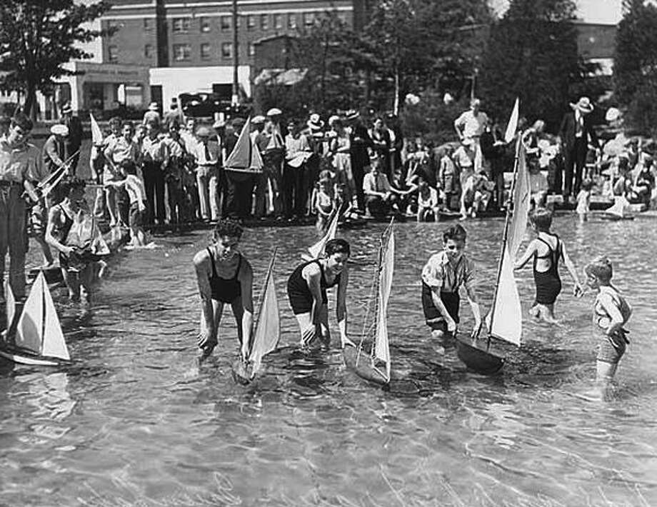 Boys sailing boats at the Green Lake wading pool, 1934. (Seattlepi.com file/MOHAI) Photo: P-I File