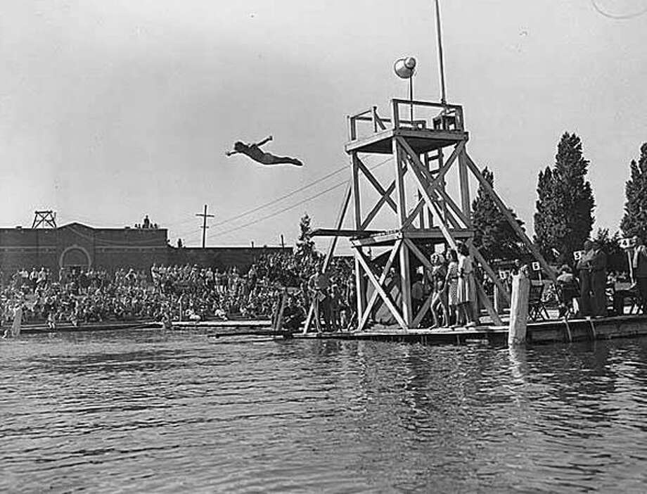Divers at a Green Lake platform, 1941. (Seattlepi.com file/MOHAI) Photo: P-I File