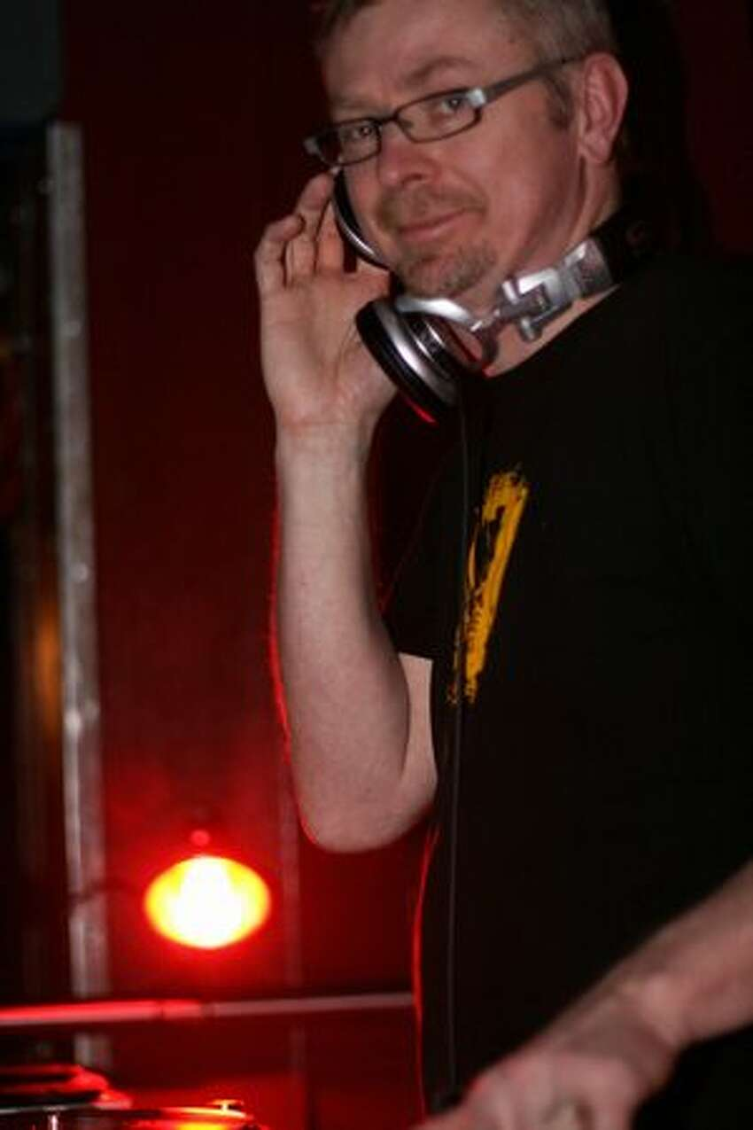 DJ Darek Mazzone of Seattle indie station KEXP entertains at the party.