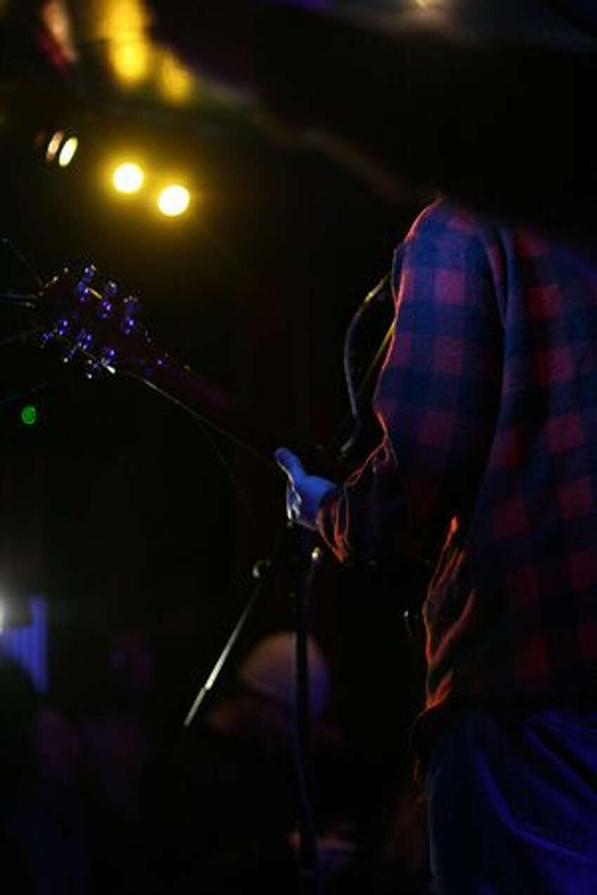Kevin Murphy, guitarist and lead singer for the Seattle-based band the Moondoggies, performs at the Seattle Party.