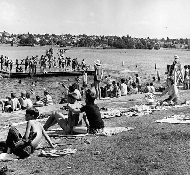 A crowd at the west Green Lake beach during a P-I-sponsored swim class. July 13, 1965.