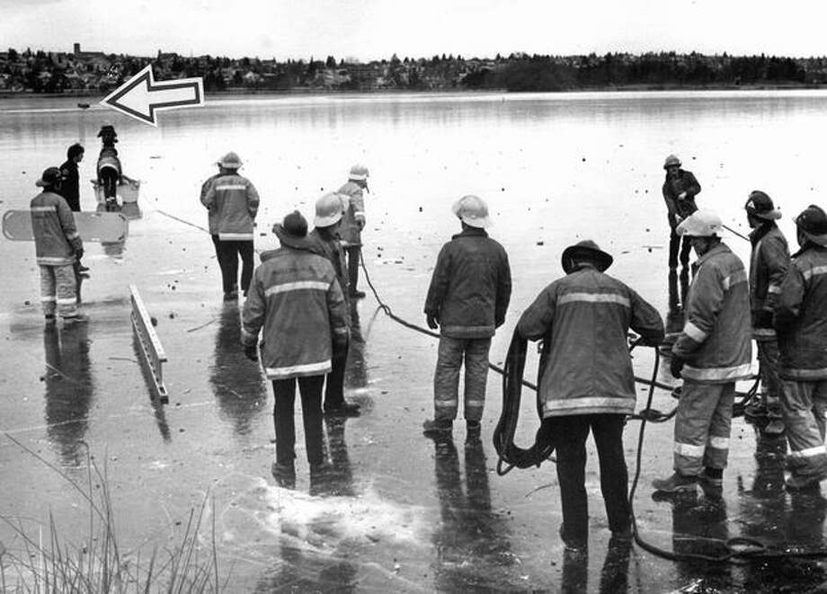 The arrow shows the object of rescuers' efforts at Green Lake, Jan. 4, 1979. (Phil H. Webber/Seattlepi.com file) Photo: P-I File