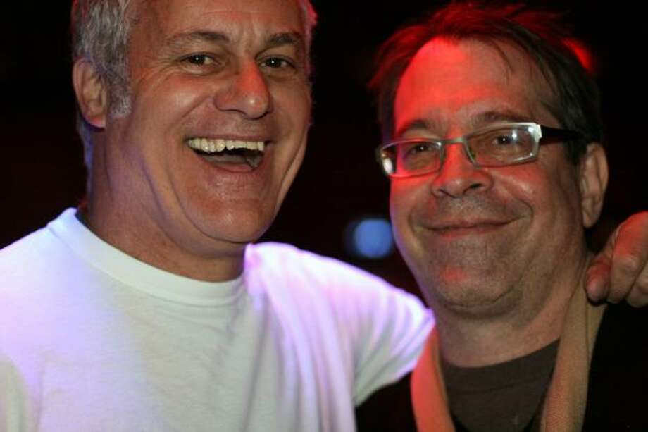 "Hollywood producer Jay Stern (right) and business partner Chip Diggins pose at the Seattle Party. Stern, producer of the ""Rush Hour"" films, is considering bringing a project to Seattle. Photo: Mónica Guzmán, Seattlepi.com"