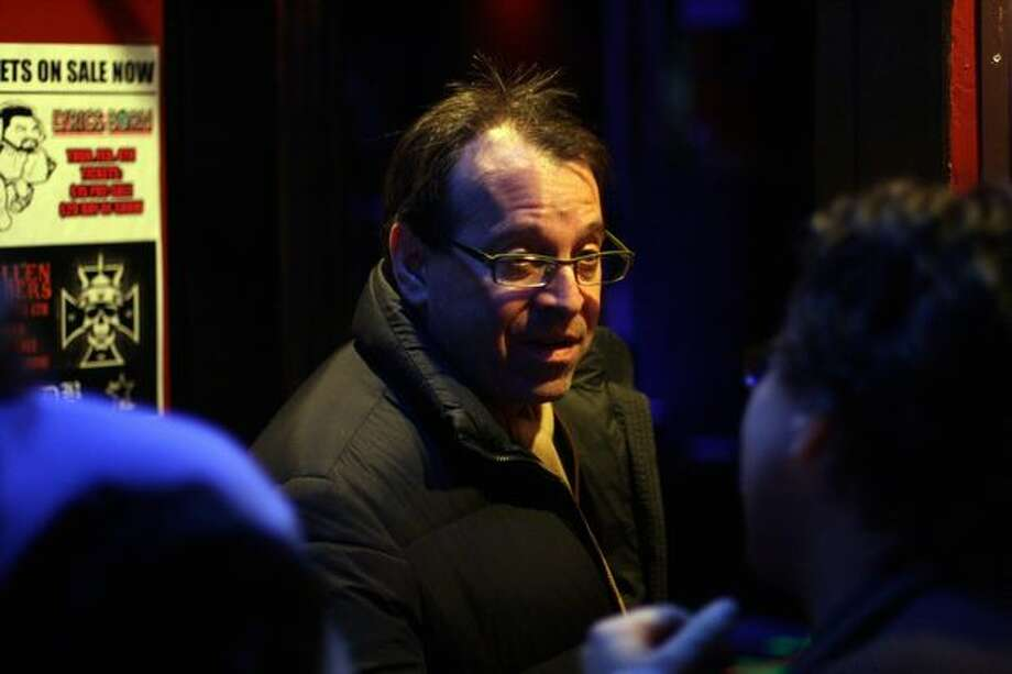 Producer Jay Stern speaks with Warren Etheredge of The Warren Report before re-entering the Seattle Party. Stern, like several other guests, had left to find a bar to watch the end of the NFL playoff game between the New Orleans Saints and the Minnesota Vikings. Photo: Mónica Guzmán, Seattlepi.com