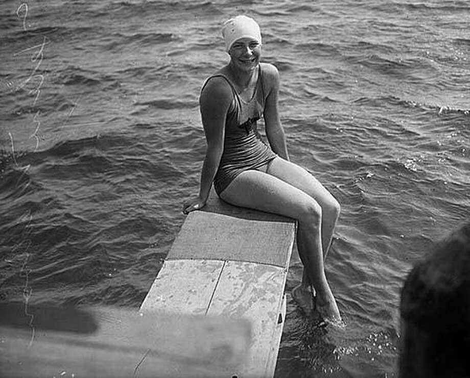 Helene Madison at Green Lake, 1930. Madison, who attended Lincoln High School, won three gold medals at the 1932 Olympics, never lost a race, won 23 national championships and at one point held every world record. Two pools in Seattle are named for her – a city pool in North Seattle and a pool at the Washington Athletic Club, where she practiced. Read more about Madison here. (Seattlepi.com file/MOHAI) Photo: P-I File