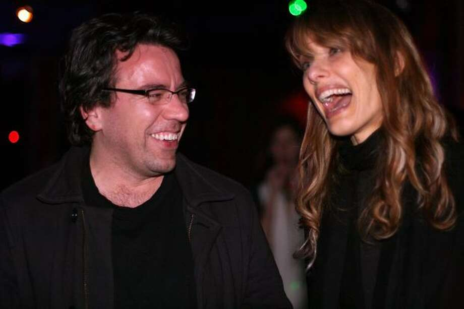 "Warren Etheredge of The Warren Report shares a laugh with Lynn Shelton, Seattle director of the 2009 Sundance hit ""Humpday"" and the upcoming MTV Web series ""$5 Cover: Seattle,"" at the Seattle Party. Photo: Mónica Guzmán, Seattlepi.com"
