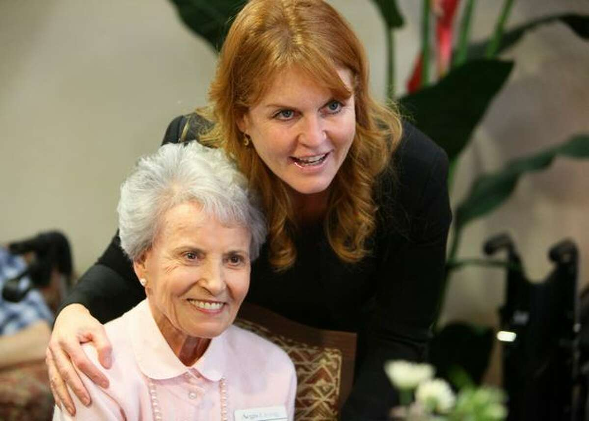 Sarah Ferguson, the Duchess of York, has her photo taken with Mary Sarich during a visit to Aegis Living of Shoreline.